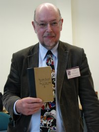 Edward Wakeling with a replica of the first Charles Dodgson journal