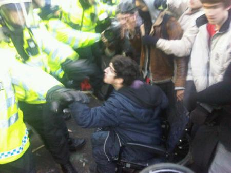 police dragg Jody McIntyre from his wheelchair