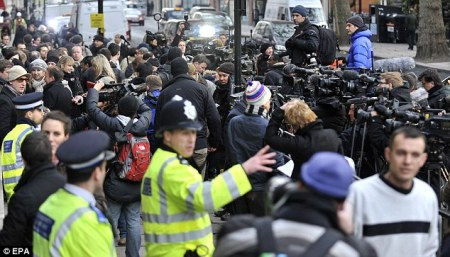 International media mingle with police and protesters outside court