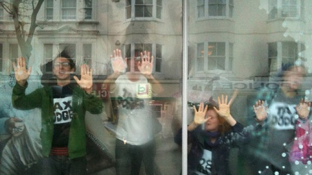 Demonstrators glue their hands to the window Topshop Brighton - Cathy Jones