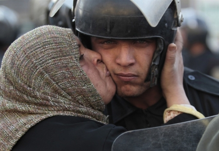 Subversive protest: Egyptian protestor kisses riot police officer
