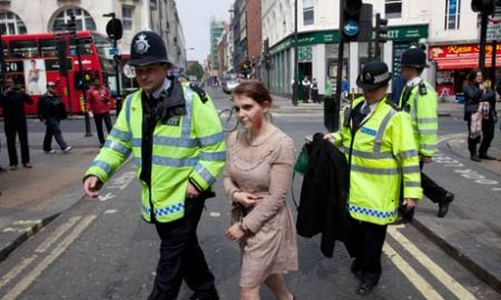 Police detain a woman in Oxford Street dressed as a zombie