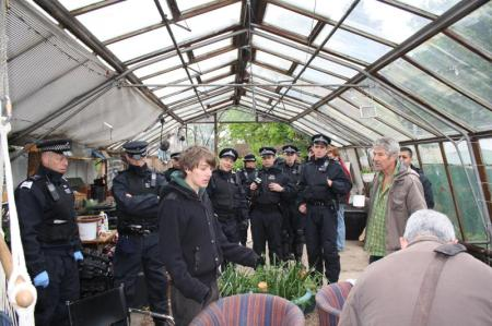 Transition Heathrow riot police raid a greenhouse
