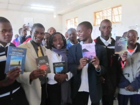 schoolchildren in Mozambique with books by Paulo Coelho