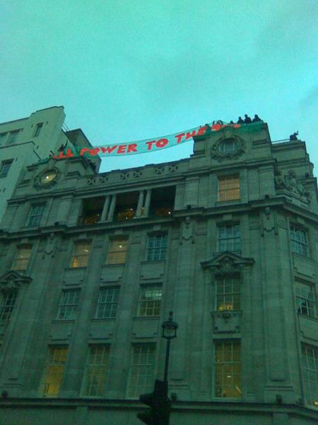 Power to the 99% banner drop Panton House