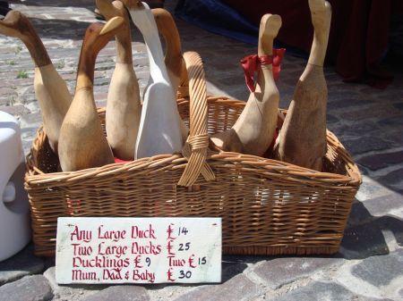 wooden ducks in a basket