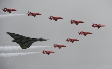 Vulcan with Red Arrows in V formation