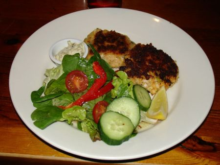 two fish cakes and greenery