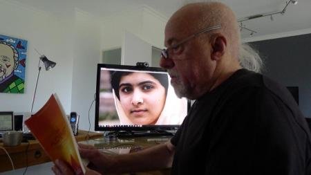 UN Messenger of Peace Paulo Coelho with Malala on screen