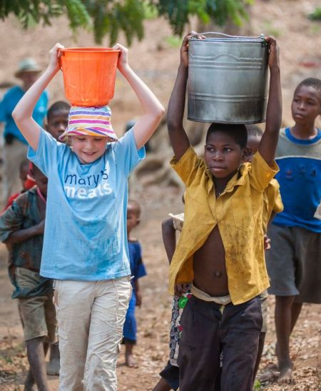 NeverSeconds Martha Payne carrying water in Malawi