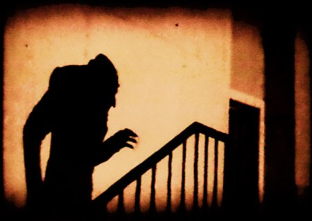 shadow of Nosferatu (Count Orlok aka Dracula) climbing up a staircase