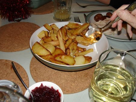 Christmas dinner: roast parsnips and potatoes