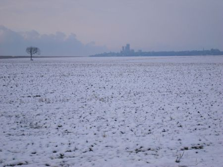 Lincoln Cathedral seen across snow covered fields