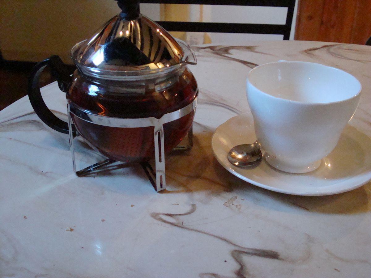 Assam tea served in unusual glass spherical tea pot