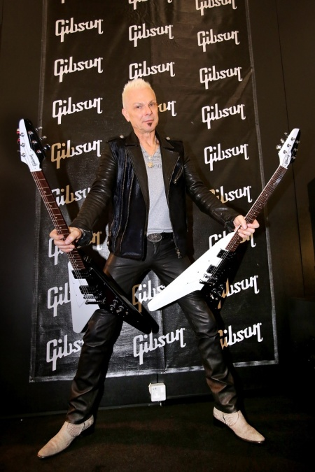 Rudolf Schenker with two flying V Gibson guitars