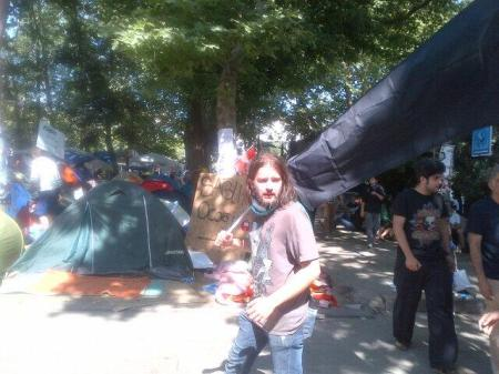 Red-eyed protesters streaming to Gezi Park Medical Tent to splash milk on their eyes, tear gas wafting from Taksim Square
