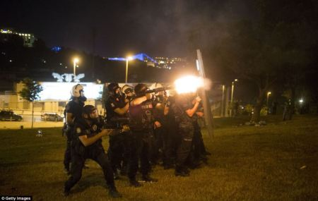 Police firing tear gas on unarmed protesters