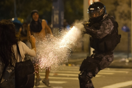 A military policeman from the special unit Chope fires a tear gas gun late on June 19, 2013 to disperse protesters during clashes in the center of Niteroi, 10 km from Rio de Janeiro. Protesters battled police late on June 19, even after Brazil's two biggest cities rolled back the transit fare hikes that triggered two weeks of nationwide protests. (Christophe Simon/AFP/Getty Images)