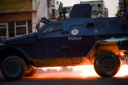 A Bahraini riot-police car is hit by a petrol bomb during clashes with demonstrators following the funeral of Hussein Abdullah, in the village of Saar, west of Manama, on June 26, 2013. (Mohammed Al-Shaikh/AFP/Getty Images)
