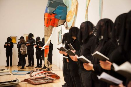 Fifty veiled figures dressed in black today carried out a performance art installation entitled 'Parts Per Million'