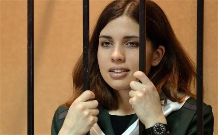 Pussy Riot punk band member Nadezhda Tolokonnikova standing in the defendant's cage in a court in the town of Zubova Polyana, Mordovia in April this year