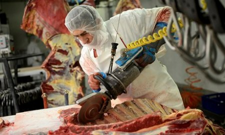 A worker cuts up a carcass in an abattoir in eastern Europe