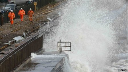 Dawlish  railtrack workers working in six-hour shifts - between high tides - to repair the track