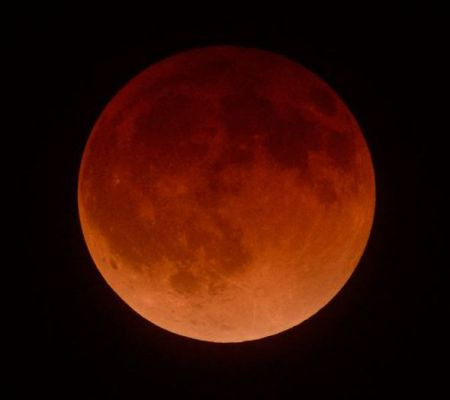 blood moon in its final stage of eclipse above Los Angeles