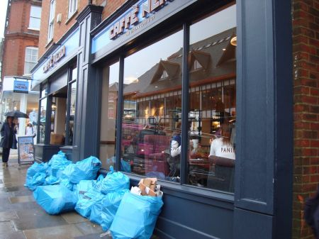 tax dodger Caffe Nero rubbish piled in the street