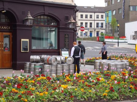 outside The Queen Hotel kegs piled high