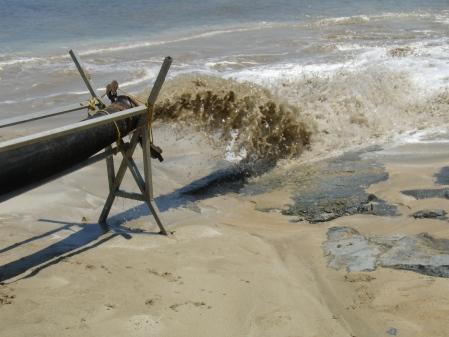 silt and sand spewed onto the beach