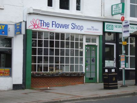 flower shop, burnt out, relocated, now closed