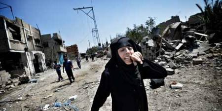 A woman in Zanna is overcome by the destruction in the village following heavy Israeli tank fire and air strikes over almost a week.