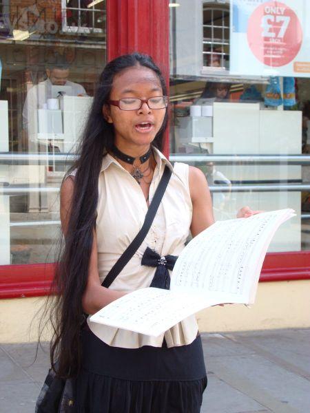 lady singing in High Street