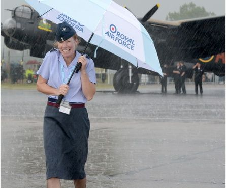 Squadron Leader Paula Willmot braves the rain
