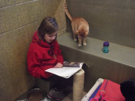 8 year old Mattighan Pagan loves to read to the cats