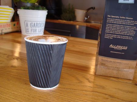 cappuccino and Allpress coffee beans