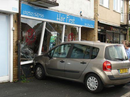 car drives through  hairdressers