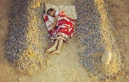 Syrian boy sleeping between his parents