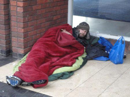 homeless sleeping rough in abandoned shop doorways