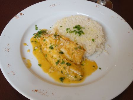 fillet of sea bass with white wine and garlic served rice