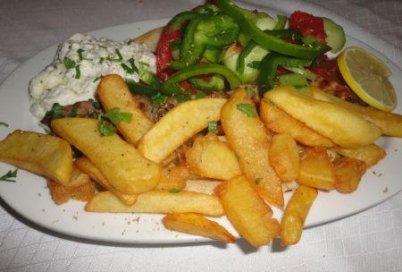 souvlaki served with salad and chips