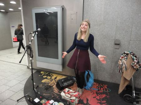 Charlotte Campbell busking at King's Cross