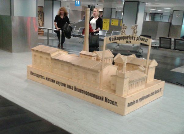 wooden sculptures end of luggage belt
