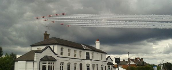 Red Arrows fly past over The Swan