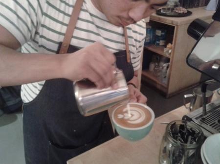 barista champion Dan pouring the milk