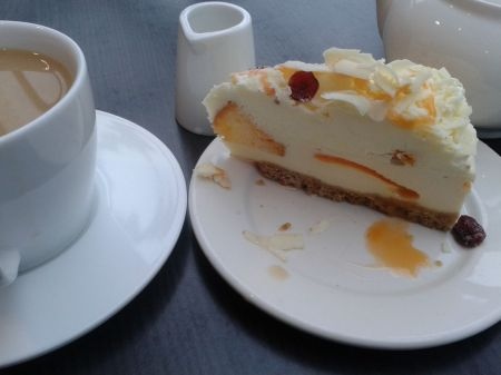 cheesecake and a pot of tea